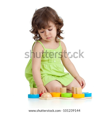 little girl playing with cup toys, isolated over white