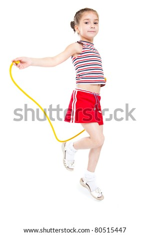 Little girl playing with jumping rope. Isolated on white