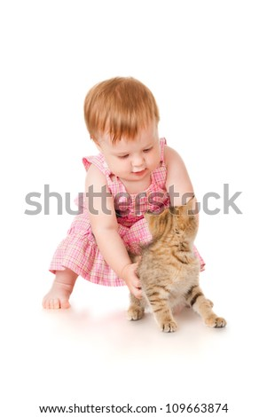 Little girl playing with kitten, isolated on white - stock photo