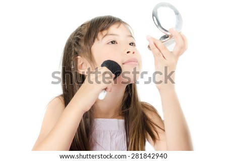 Little girl playing with make up