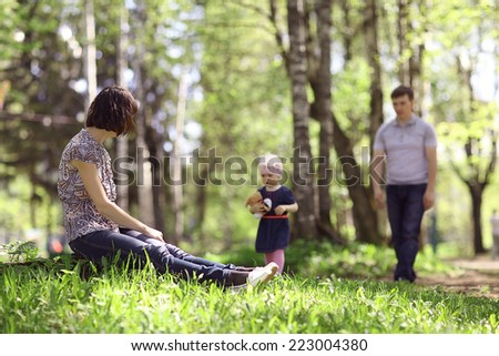 little girl playing with mom - stock photo