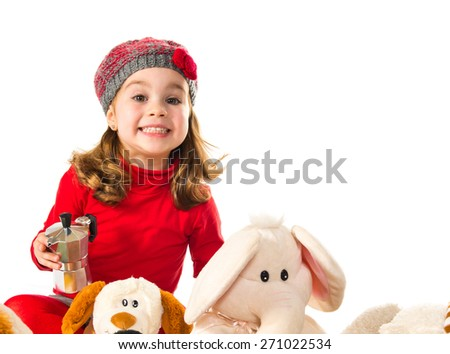 Little girl playing with stuffed animals