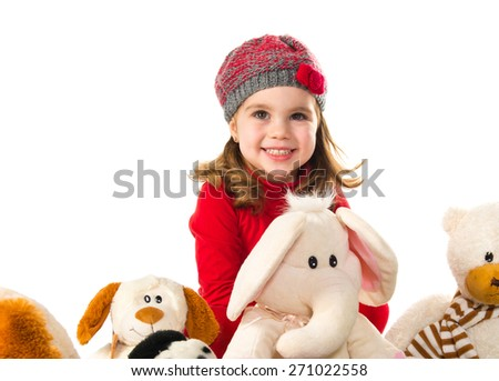 Little girl playing with stuffed animals - stock photo