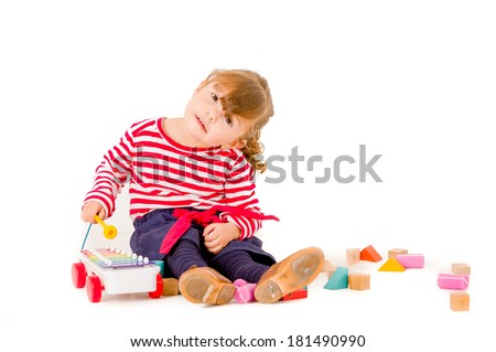 Little girl playing with wood blocks