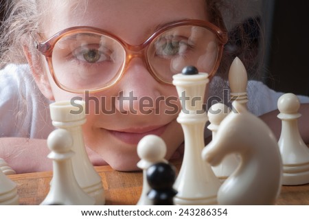 little girl plays chess