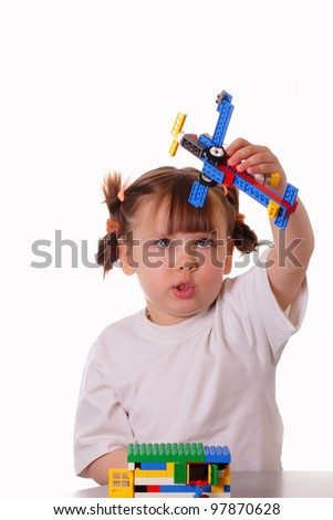 Little girl plays with a toy airplane - stock photo