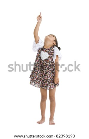 little girl pointing and looking up, isolated on white background