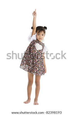 little girl pointing up, isolated on white background - stock photo