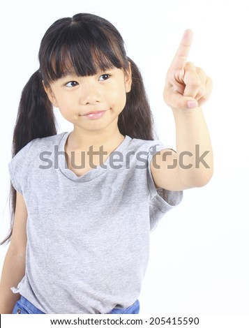 Little girl pointing up with her finger  - stock photo
