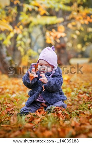 Little girl portrait in autumn park
