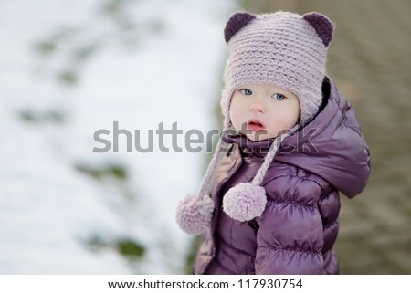 Little girl portrait on winter day in city - stock photo