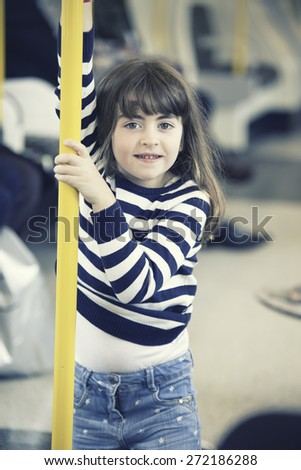 Little girl portrait standing in the subway - stock photo