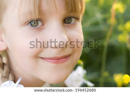 Little girl portrait summer outdoors