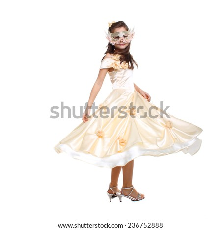 little girl posing in the carnival mask and festive dress - stock photo