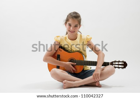 Little girl posing with guitar