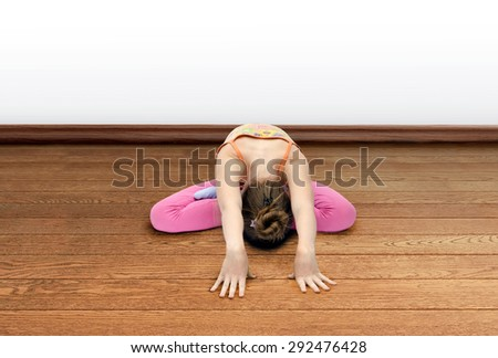 little girl practices yoga - stock photo