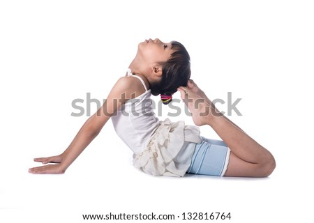 Little girl practicing yoga isolated on white background - stock photo