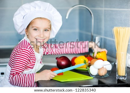 Little girl preparing healthy food on kitchen - stock photo