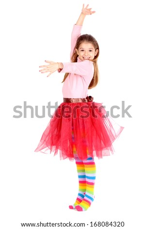 little girl pretending to be a dancer