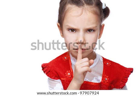 Little girl put her finger to her lips as sign of peace, isolated on white background. - stock photo
