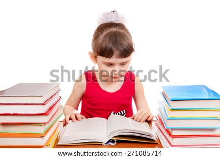 Little Girl read the Book at the Desk on the White Background - stock photo