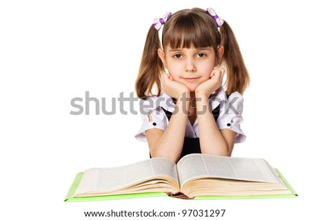 Little girl reading a book. Isolated on white background