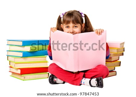 Little girl reading a book on the floor looking up. Isolated on white background