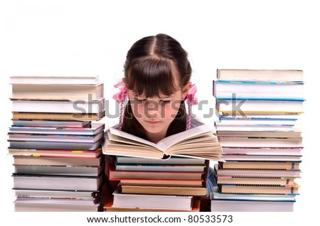 Little girl reading a book sitting among stacks of books isolated on white background