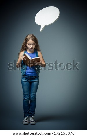 Little girl reading a book with bubbles - stock photo
