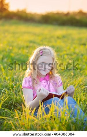 little girl reading book - stock photo
