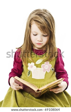 Little girl reading book, isolated on white background - stock photo