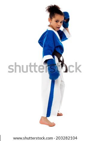Little girl ready to pack a punch - stock photo