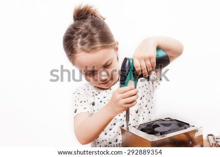 Little girl repair a computer component