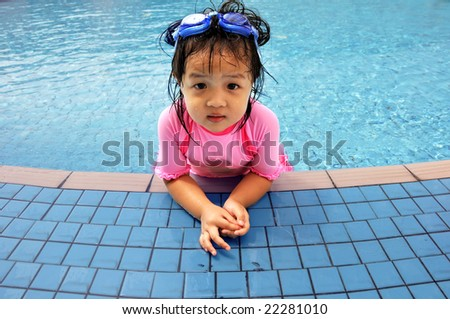 little girl resting at the swimming pool - stock photo