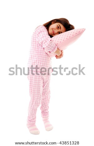 Little girl resting her head on pillow isolated on white