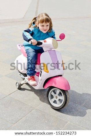 little girl ride a motorcycle
