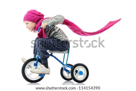 Little girl rides a bicycle on white background - stock photo