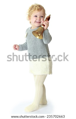 Little girl rings the bell smiling cheerfully.White background, isolated photo.