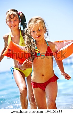Little girl  running on  beach. - stock photo