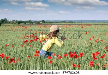 little girl running on meadow spring season - stock photo