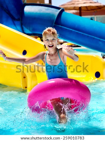 Little girl running with inflatable ring.