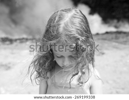 little girl sad smoke - stock photo