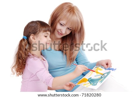 Little girl showing her mother a drawing