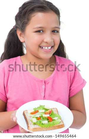 Little girl showing her sandwich to camera on white background