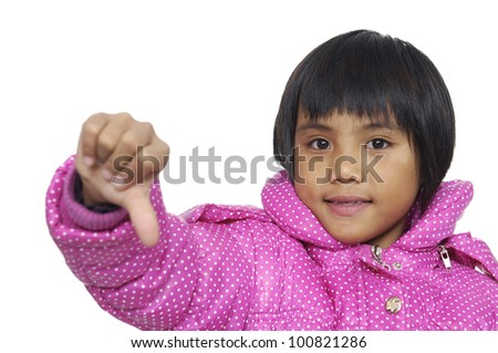 Little girl showing thumb down.