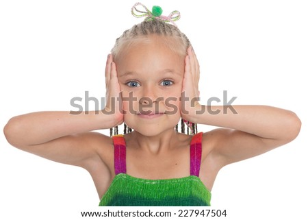 Little girl shows a pose I can not hear. Girl is six years old. - stock photo