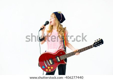 little girl singing a song with a microphone and a guitar on a white background. Isolate  - stock photo