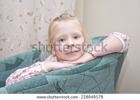little girl siting on a chair - stock photo