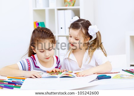 Little girl sitting and studying at home