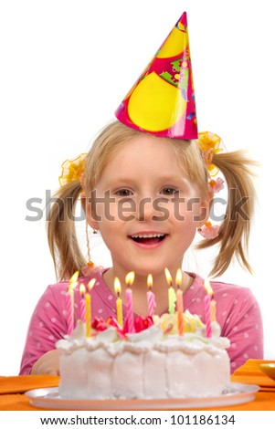Little girl sitting at the table with cake in her birthday - stock photo